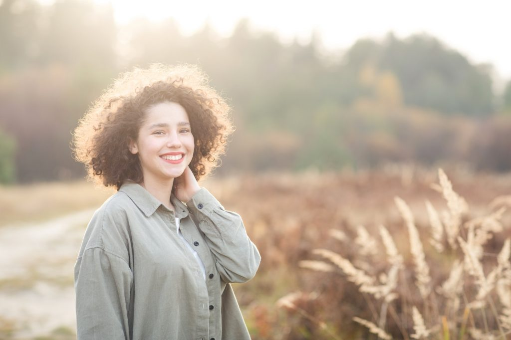 portrait of young pretty mixed race teen girl outdoor in sunlight.